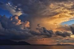 Approaching dusk squall, near Huahine, Polynesie Francalse (Timothy Hastings) Tags: ocean sunset sea sky sun seascape storm nature rain squall french landscape polynesia islands nikon pacific wind south southpacific tahiti nikkor drama tropics huahine seas d810 diusk
