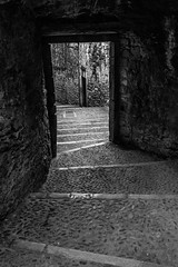 It's your decision (Bazzography! kind of back in action) Tags: blancoynegro monochrome blackwhite spain alley noiretblanc foreboding fear catalonia girona espana doorway alleyway catalunya goingdown threshold bazmatthews