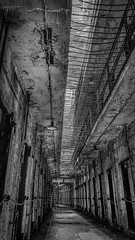 Kashmir (toddrogersphotography) Tags: travel urban philadelphia architecture clouds buildings landscape bars gates decay bricks oldbuildings haunted spirits prison daytime alcapone hauntings fallingapart sanitarium prisoncells easternstatepenitantuary