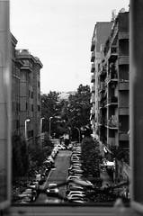 Nightfall (idlike2sleep) Tags: light blackandwhite white black rome cars film night analog nikon minolta scanner iso400 bologna hp5 dimage ilford fm2 fm2n