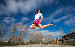 Flying is the safest way of travel. (Flickr_Rick) Tags: woman girl outside spring jump jumping legs bluesky skirt brunette jumpology