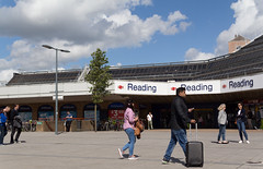 Going places (KevPBur) Tags: travel people reading windy sunny railwaystation suitcase berkshire readingstation sigma30mmf14exdchsm canon650d canonrebelt4i canonkissx6i canon650dcanonkissx6icanonrebelt4i