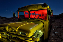 after school special. goldfield, nv. 2015. (eyetwist) Tags: eyetwistkevinballuff eyetwist night nevada goldfield carforest schoolbus dark longexposure long exposure startrails star trails fullmoon desert nikon nikond7000 d7000 nikkor capturenx2 1024mmf3545g photography npy nocturne lightpainting flashlight gels highdesert americana americantypology american typology dead empty wasteland shadows abandoned desolate lonely car cars autos classic rust rusty junk wrecked derelict decay patina faded weeds dented rusted internationalcarforestofthelastchurch lastchurch bus carhenge buried dirt forest schoolofrock red school yellow otto grille chevy chevrolet