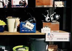 Reel Deals - Deal, Kent (jcbkk1956) Tags: 45mmf28 rokkor minolta a5 rangefinder analog film 35mm agfa200 fishing reels tackle window shopwindow deal kent worldtrekker
