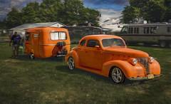 Canadian OJ (Steve Walser) Tags: trailer traveltrailer camping rv boler orange car