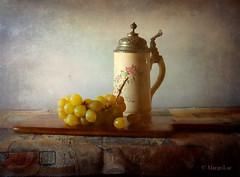 Autumnal Still Life ... (MargoLuc) Tags: natura morta grapes boccale vintage uva tagliere wooden ancient light window natural soft stilllife golden shadows texture skeletalmess