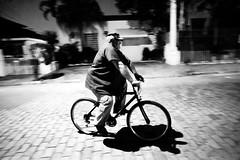 (p.marinuzzi) Tags: street city brazil bw white man black bike bicycle brasil night work photography saopaulo sãopaulo fat working bicicleta sp noite approved rua paulo fotografia gil panning homem são gordo vigia noturno fotografiaderua marinuzzi paulomarinuzzi streetphotographystreetphotography selvasp