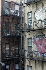 Blight or home? (andyscho2004) Tags: nyc newyorkcity windows usa ny newyork home graffiti nikon chelsea apartments decay poor angles fireescape balconies gentrification controversy blight urbanrenewal tenements balustrades 10thavenue thehighline west22ndst d7100 west23rdst
