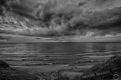 Tramonto in HDR  .. Sunset in HDR (JackTorva) Tags: sunset sea sky italy panorama white black beach nature clouds canon landscape eos surf italia tramonto nuvole mare ngc natura cielo e 7d infinito bianco nero spiaggia hdr lazio onde anzio 14mm samyang grandangolare