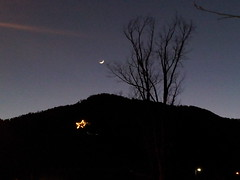December 23, 2014 - The moon sets above a holiday star in Boulder.  (David Canfield)