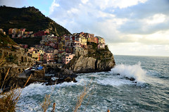 318/365 (moke076) Tags: world ocean old city sunset sea vacation sky italy heritage water oneaday skyline clouds buildings town site italian nikon colorful europe riviera european afternoon bright liguria wave cliffs unesco photoaday terre colored grasses 365 sentiero azzurro manarola cinque 2014 terraced project365 365project d7000 azuretrail