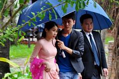 Beating the rain (Roving I) Tags: rain weather guests events festivals culture vietnam hoian umbrellas danang silkvillage