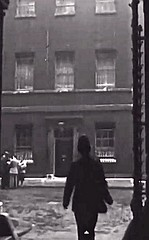 A Cannon Row (Alpha Delta) 'A' Or Whitehall Division Police Constable Makes His Way To His Post From The Foreign Office To No 10, Downing Street, Westminster, London, SW1. UK. circa 1947. (sgterniebilko) Tags: uk london westminster westminsterabbey ad whitehall sw1 downingstreet foreignoffice metropolitanpolice alphadelta policeconstable canonrow cannonrowpolicestation