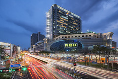 Bangkok Vibe @MBK (tapanuth) Tags: city longexposure nightphotography travel urban building tourism car skyline modern mall shopping office twilight asia cityscape traffic bangkok capital landmark busy departmentstore destination lighttrails bluehour southeast attraction crowded architure thailad
