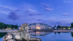 The guardian of the castle (ColognePhotograph) Tags: blue sunset reflection castle nature water photography lights photo wasser atmosphere schloss teich photoart atmosphre guardian mnster lichter nordkirchen reflektionen wchter colognephotograph
