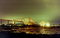 The Northern Lights seen over the Forth Bridge. (Michael's pics... (The Amateur Wanderer)) Tags: bridge london film night 35mm river photography lights coast scotland iron north rail railway olympus structure system east forth aurora 24mm om northern eastern zuiko om1 f28 lattice borealis mainline ecml anologue
