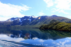 Norway (Joseph W Ling) Tags: blue cloud mountain snow seascape reflection green ice nature water norway landscape scenery quiet peaceful tranquility reflect mountainside