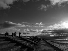 Walk along the sea front (glen.chappell) Tags: sunshine sea beach people iphone dramatic silhouette seaside blackwhite sunset seafront walking