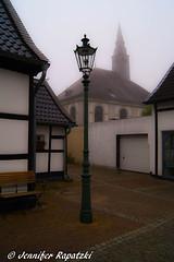 Old street in fog (Bernsteindrache7) Tags: summer sony alpha 100 spring city color landscape outdoor fog church heaven himmel sky