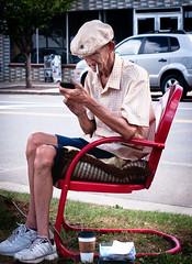 iSmoke (hutchphotography2020) Tags: cigarettes smoking oldman iphone citystreets metalchair intown streetscene nikon