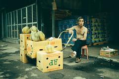 Durian Seller (juliusengel) Tags: durian seller hong kong asia smoking smoke men human portrait market vintage canon 5d 35mm f14