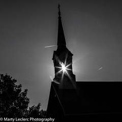 Guided .... (Marty 1955 ...) Tags: blackwhite sun sunny trees martyleclercphotography skyline canada country wakefield church sunflare burst contrail holy