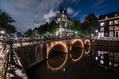Time Flies (McQuaide Photography) Tags: amsterdam noordholland northholland netherlands nederland holland dutch europe sony a7rii ilce7rm2 alpha mirrorless 1635mm sonyzeiss zeiss variotessar fullframe mcquaidephotography adobe photoshop lightroom tripod manfrotto light licht night nacht nightphotography longexposure stad city capitalcity urban lowlight architecture outdoor outside old oud gracht grachtenpand canalhouse house huis huizen traditional authentic water reflection centrum gebouw building waterfront waterside canal colour colours color wideangle groothoek wideanglelens windows keizersgracht astoria bridge brug arch illuminated jugendstil history historic historicalbuilding landmark tower