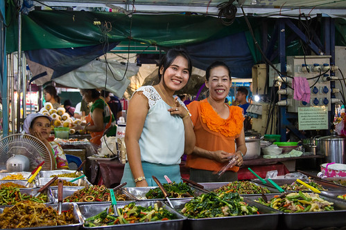 Happy food ladies selling Thai food