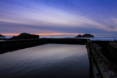 Sutro Baths at Sunset (louisraphael) Tags: california lighting blue light sunset red orange sun seascape storm reflection rain fog sunrise reflections painting landscape outside outdoors mirror landscapes seaside san francisco paint glow shine purple united horizon sunsets stormy baths stunning end sutro states lands striking picturesque cliffhouse stun