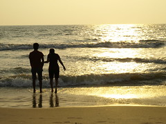 Silhouette of a couple on beach (Sripathy Ramesh) Tags: ocean sunset sea people sun beach water silhouette evening sand couple dusk romance lovers