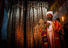 Ethiopian orthodox priest holding a cross inside a rock church, Amhara region, Lalibela, Ethiopia (Eric Lafforgue) Tags: africa travel man color men horizontal outdoors worship candle cross adult african faith religion unescoworldheritagesite celebration holy indoors sacred priest christianity shawl spirituality ethiopia orthodox religiouscelebration oneperson candlelit traditionalculture lalibela hornofafrica ethiopian eastafrica thiopien etiopia abyssinia ethiopie traditionalclothing etiopa onlymen onemanonly onematuremanonly  etiopija 1people ethiopi  africanculture etiopien etipia  etiyopya  amhararegion         semienwollozone ethio163627