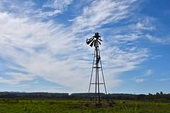 battling windmill (J.R.P) Tags: blue sky windmill rural wind farm