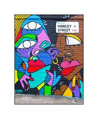 Graffiti (Hunto), North London, England. (Joseph O'Malley64) Tags: uk greatbritain england streetart london sign wall graffiti mural paint britain pavement spray signage gradient roadsign british walls cans aerosol pointing brickwork incline wallmural northlondon muralist accesscover hunto