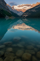 Lake Louise Sunrise (Erik Pronske) Tags: canadianrockies sunrise rockymountains nationalpark mountains sydney relection rocks banffnationalpark blue australia newsouthwales water alberta trees mountvictoria canada lakelouise still banff canoe improvementdistrictno9 ca