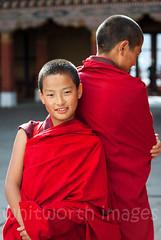 Bhutanese Monks (whitworth images) Tags: young asian portrait spiritual scarlet devout buddhist himalaya dzong person himalayas two robe bhutan boy red religion religious man ringpongdzong people parodzong travel monastery friends maroon male crimson monks asia fabric bhutanese paro parodzongkhag