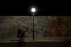 Rose in the City (manuel.gros) Tags: city light people streetart rose night contrast graffiti licht nikon alone nacht romance menschen stadt lantern nikkor laterne kontrast romantik allein strasenkunst 18105mm d5100