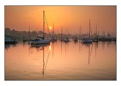 SUNRISE OVER LYMINGTON RIVER (Steve Elson1) Tags: sea reflection water sunrise river boats coast harbour hampshire quay yachts lymington