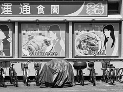 Under Cover #013 (Peter.Bartlett) Tags: city urban blackandwhite monochrome bike sign poster singapore streetphotography cycle tarpaulin undercover m43 lunaphoto urbanarte niksilverefex microfourthirds peterbartlett olympusomdem5