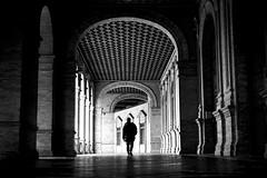 Through the arches (fernando_gm) Tags: street people blackandwhite bw man blancoynegro architecture contrast calle sevilla spain arquitectura arch fuji gente seville human fujifilm humano arco hombre callejera xt1