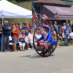 "Keith Dufrane and his ""Monowheel"" (oxfordblues84) Tags: street columbus ohio people man guy outdoors flag parade columbusohio spectators starsandstripes shortnorth unclesam usaflag victorianvillage doodah doodahparade holidayparade monowheel fourthofjulyparade fourofjuly keithdufrane"