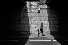 Under the spotlight (Lucas Calabrin) Tags: street city people urban blackandwhite motion monochrome nikon lyon passing
