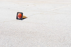 Fallen (Liza Williams) Tags: hotday summer orangetrafficcone orangecone orange everydaymadeartistic trafficconeinaparkinglot knockedover negativespace claytoncounty lakespiveyevent thebeach event neighborhood cone trafficcone parkinglot sunny bright sunshine asphalt park claytoncountyinternationalpark lavishperspective lavishperspectivephotography lizawilliams lizacochran lakespivey lightroom