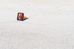 Fallen (Liza Williams) Tags: everydaymadeartistic trafficconeinaparkinglot knockedover negativespace claytoncounty lakespiveyevent thebeach event neighborhood cone trafficcone parkinglot sunny bright sunshine asphalt park claytoncountyinternationalpark lavishperspective lavishperspectivephotography lizawilliams lizacochran lakespivey