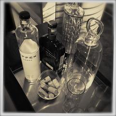 Mixologically Speaking (MPnormaleye) Tags: bw glass monochrome bar composition blackwhite bottles cork liquor alcohol utata tray vodka gin platinum tabletop