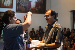 MbYAS Oragnizer offering the Id Batch, T-shirt and cap to the trustee-Ramesh Jangle