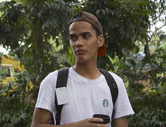 Young Artist (mikeeliza) Tags: city brown man tree cute male green hat leaves community artist skin artistic metro philippines young handsome part exotic worn manila backwards filipino pinoy quezon philippine mikeeliza guitpinas