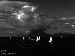 sailing in dark sea... (gregtz) Tags: sea blackandwhite bw clouds boat blackwhite sailing greece emotions patras