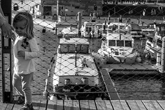 The child on the bridge (Julien M. - Turalyon) Tags: city bridge blackandwhite bw white black girl canon river eos boat child little noiretblanc rivire nb pont bateau enfant fille ville petite 60d