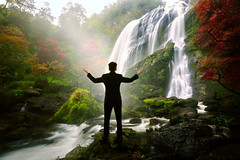 Relaxing businessman standing at waterfall (Patrick Foto ;)) Tags: park travel people white mountain man tree male green nature water beautiful beauty up businessman standing forest work relax landscape asian thailand outside person waterfall healthy hand open adult arm natural outdoor background young lifestyle business suit finish rest meditation concept copyspace conceptual relaxation stress executive job success employee complete successful kamphaengphet khlonglanphatthana