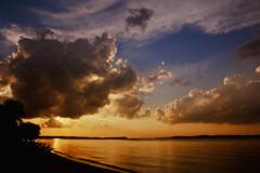 Colossal (Explored) (OzGFK) Tags: ocean sunset sun film beach water analog singapore asia afternoon fuji slide velvia pasirris nikkor nikonfm3a